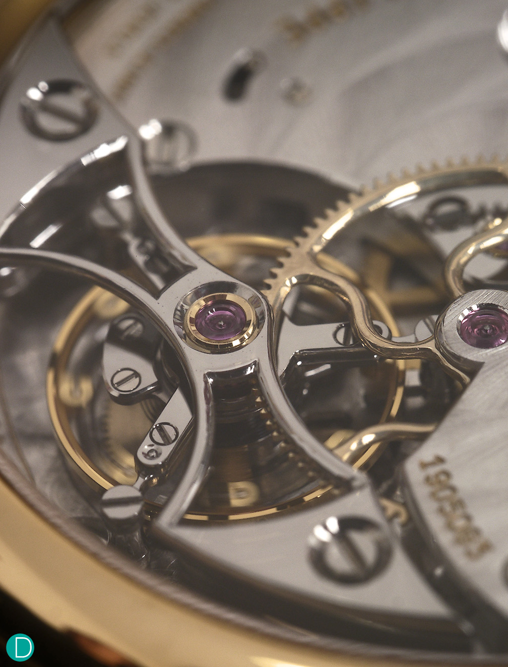 The tourbillon bridge. Classical in design and execution. Note the sharp inward and outward edges, which are very well finished. Note the polished bridge edges. Very well done.