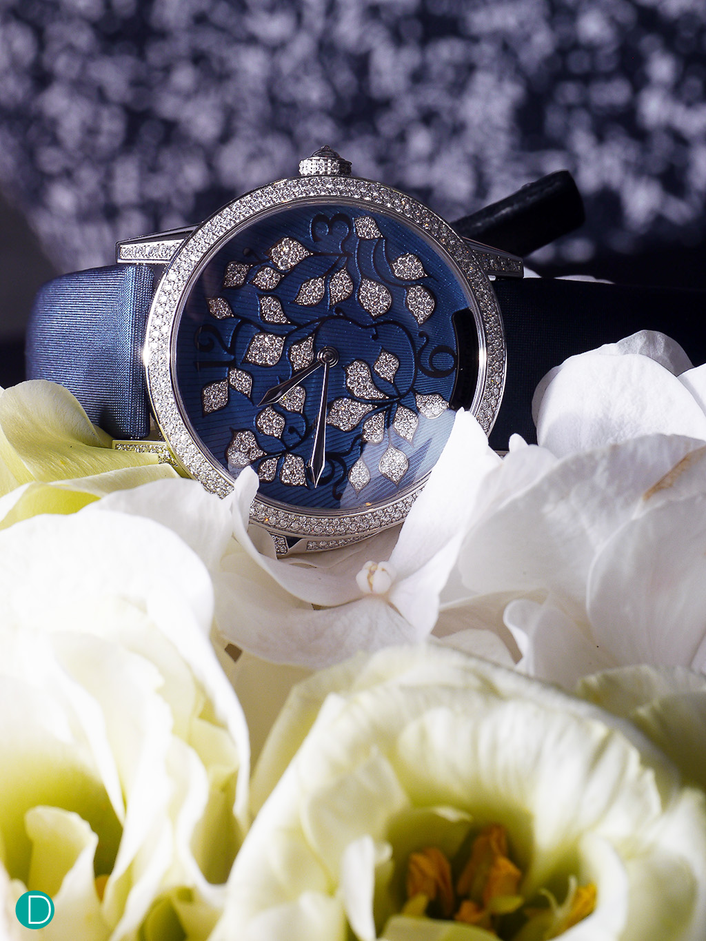 The Jaeger LeCoultre Ivy Minute Repeater, on a bed of flowers.