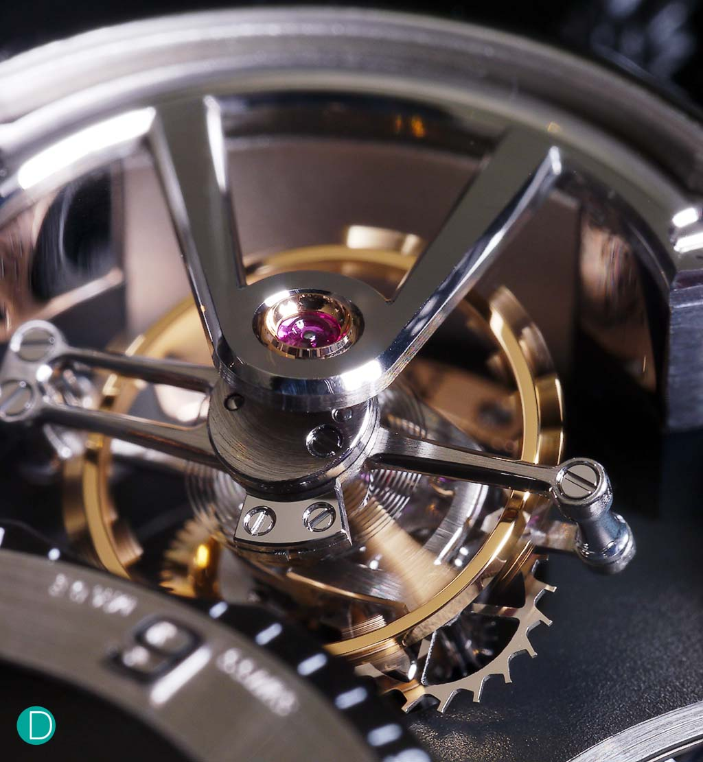 The incline tourbillon at 25deg, rotating at 24 seconds a rotation is a treat to behold. Finishing is first rate. Flat black polished steel tourbillon bridge, hand bevelled.