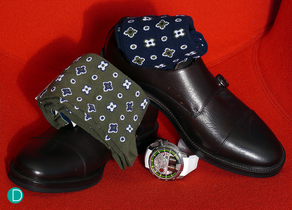 Shoes are double monk model, suitably stylish, and matched with socks which hints slightly at the motif on the pocket square. Note we intentionally selected that the colours only compliment and not match the other parts of the ensemble.
