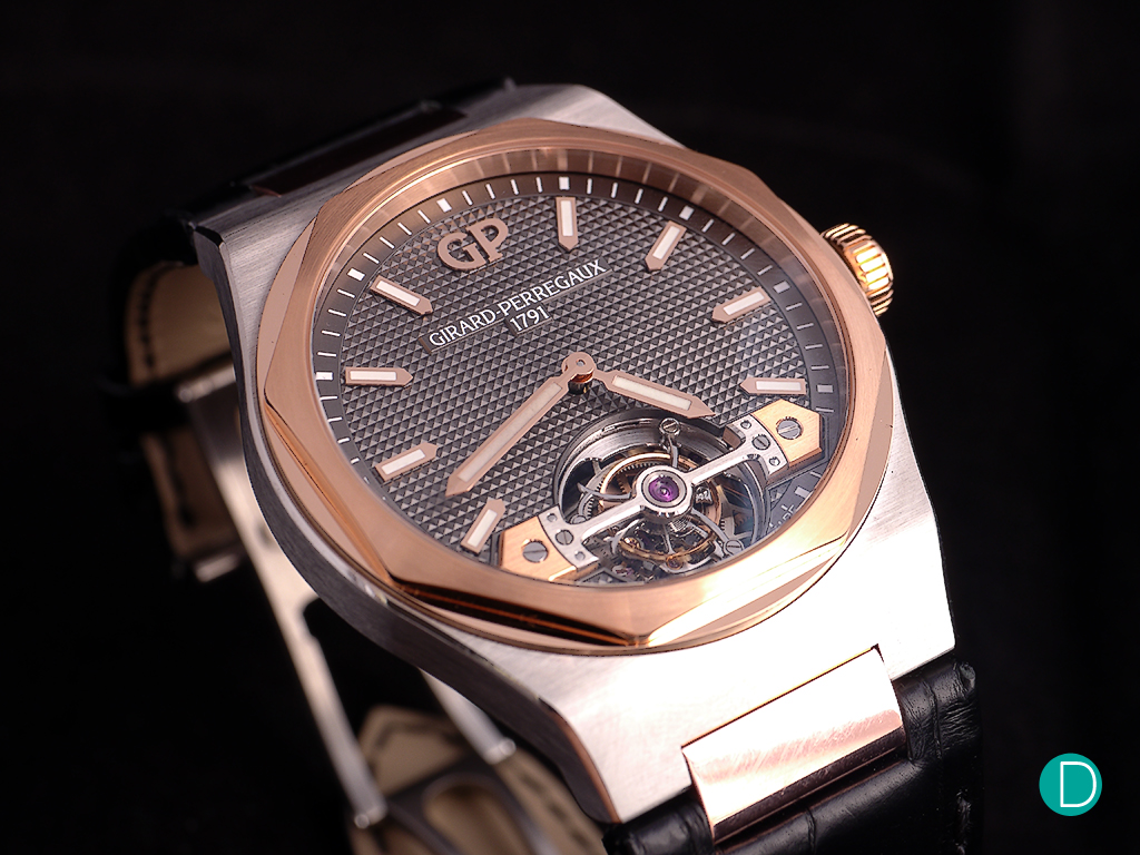 Girard Perregaux Laureato Tourbillon in titanium and pink gold. The design extends to utilize the single bridge as the focal point of the dial.