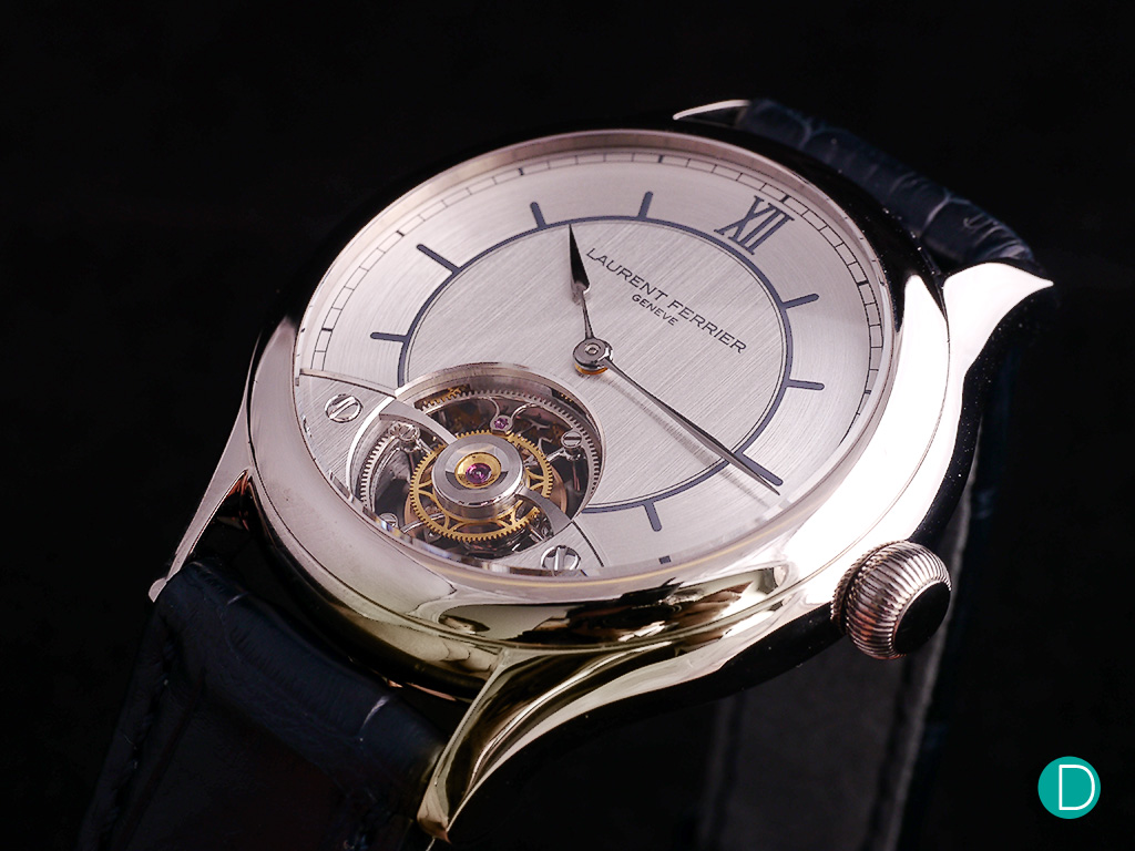 In the Galet Classic Tourbillon Double F, we see a radical design change with a tourbillon view on the dial side